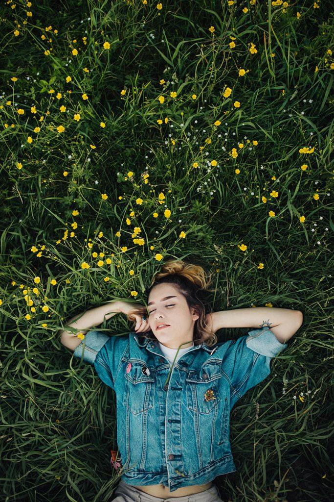 woman asleep in grass outside