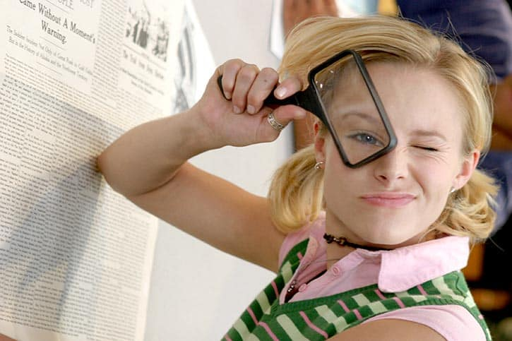 veronica mars looking through a magnifying glass