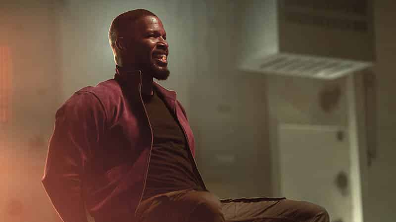 jamie foxx looks beat but has a pill up his sleeve in this project power scene