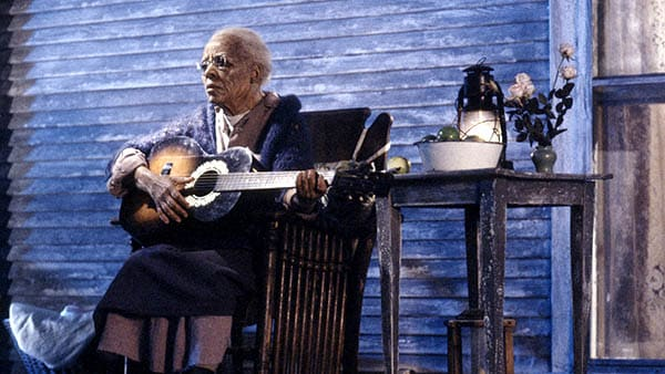 the stand (1994) miniseries mother abagail playing her guitar on the porch